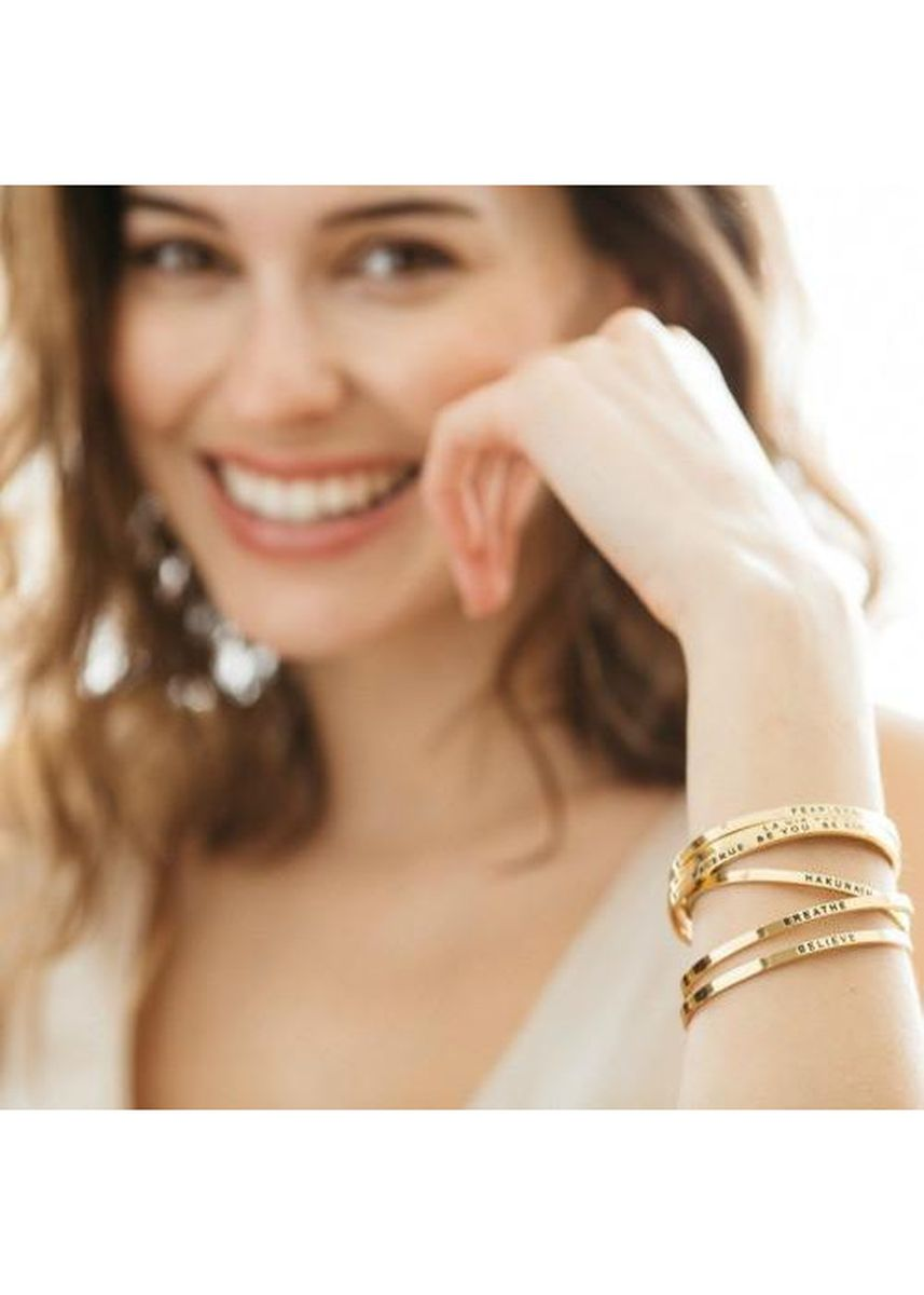 Gold color  . Mantraband Bracelet - All I Need Is Within Me -