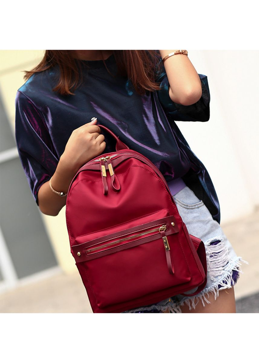 Red color Backpacks . Nylon cloth backpack -