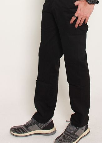 Black color Casual Trousers and Chinos . Florella Chino Pants -