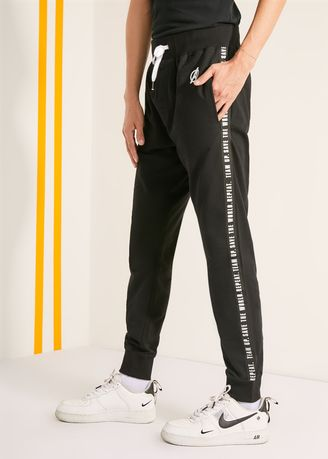 Black color Casual Trousers and Chinos . Official Save The World Black Joggers -