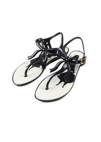 White color Sandals and Slippers . Melissa Flat Sandals -
