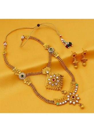 Gold color  . Sukkhi Traditional Gold Plated Kundan Long Haram Necklace Set For Women -
