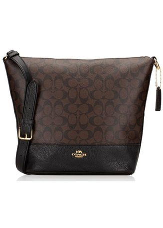 Brown color Sling Bags . coach duffle dark maho sign -