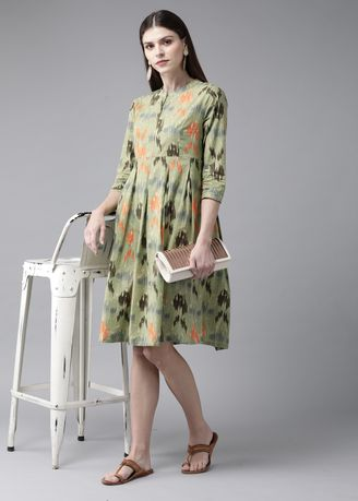 Green color Dresses . Green Printed Pleated Dress With Pocket -